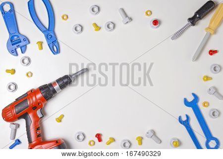 Toys tools on white background. Top view. Copy space for text