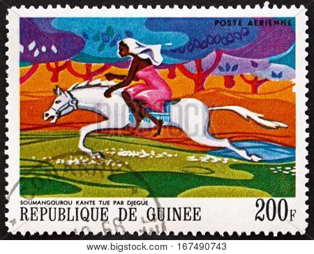 GUINEA - CIRCA 1968: a stamp printed in Guinea shows Soumangourou Kante Killed by Djegue (Woman on Horseback) African Legends circa 1968