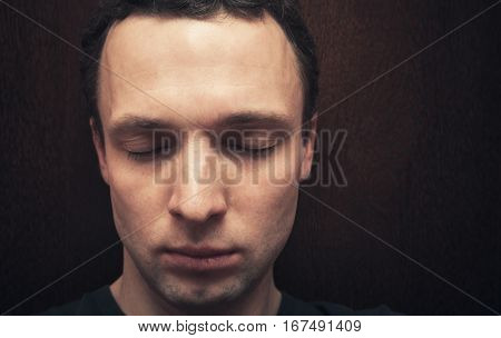 Young Caucasian Man With Closed Eyes