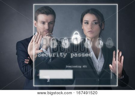 Business people enter security password and downloading file at virtual futuristic display business technology internet and network concept