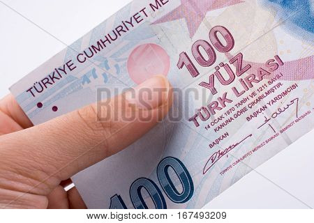 Hand Holding 100 Turksh Lira Banknotes  In Hand