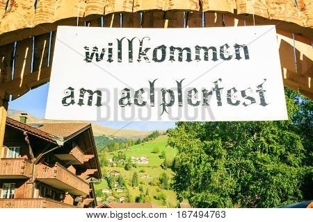 billboard welcoming visitors to the aelplerfest, the 'alp descent' festival in lenk.