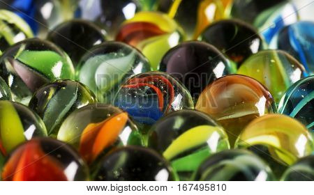 Vintage marbles are captured in a macro image.