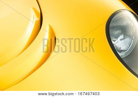 closeup abstract of golden paintwork on a luxury sports-car