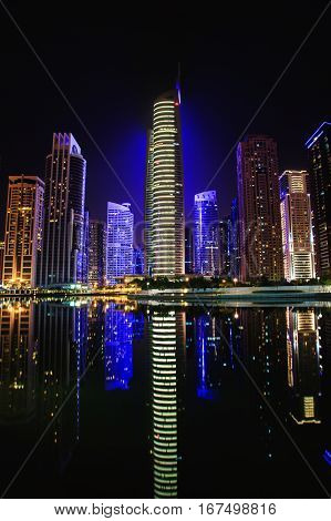View on the Jumeirah Lakes Towers skyscrapers at night. Dubai UAE.
