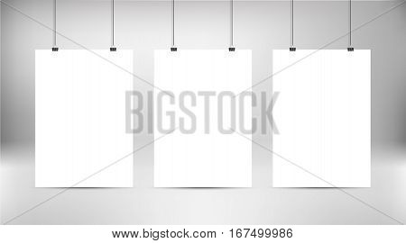 Empty white vector poster templates. Poster mock up. Template of three white blank vector posters. Set of mockups hanging on wall. Frame for paper sheet. Stock vector.