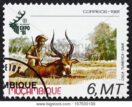 MOZAMBIQUE - CIRCA 1981: a stamp printed in Mozambique shows Hunter and Impala World Hunting Exhibition Plovdiv Bulgaria circa 1981
