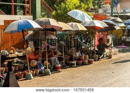 Yogyakarta, Indonesia - September 2, 2015: Vendors outside of Pasar Beringharjo, waiting for customers in the direst sunlight