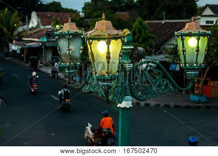 Streetlamp in front of gate to Kraton in the evening in Yogyakarta, Indonesia