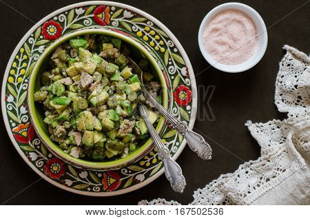 Salad With Avocado And Pickled Cucumber Cod Liver