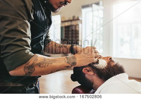 Barber Shaving Customer In Salon