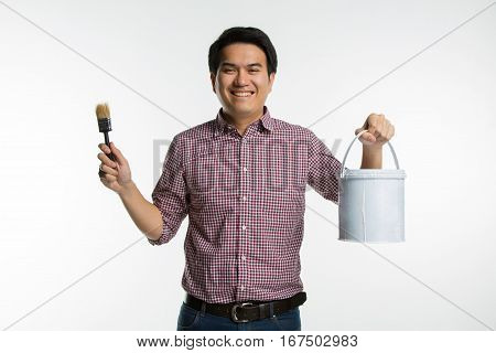 Portrait Of Young Asian Handsome Smiling Painter