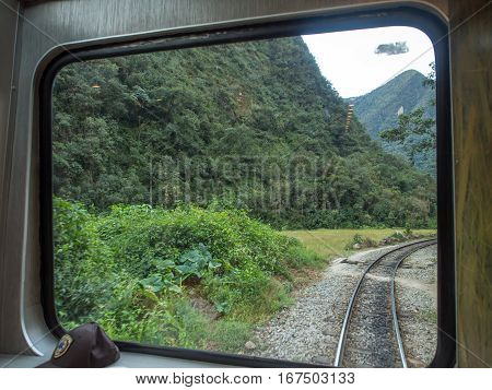 View for the Andes and track from window of PeruRail train
