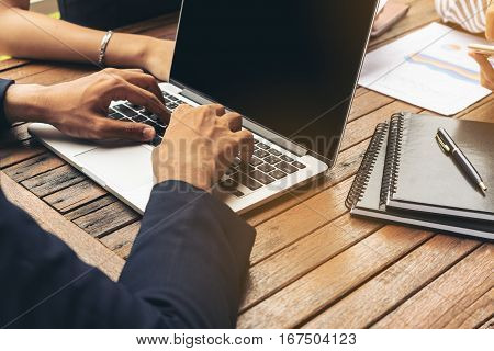 Businessman Using Laptop In Business Meeting