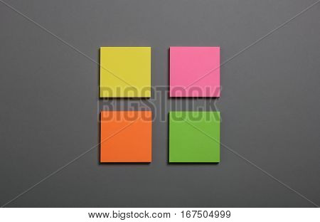 Collection of colorful post it paper note on gray background