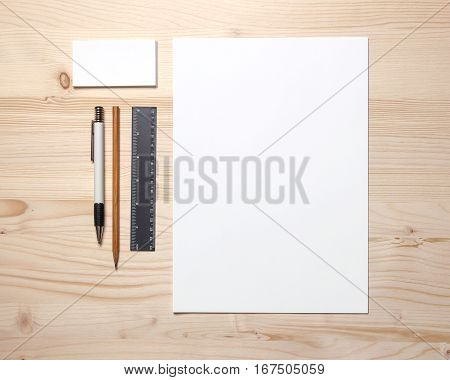 Blank stationery still life with business cards pen, pencil and ruler