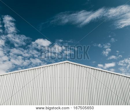 Industrial building with white corrugated sheet metal facade