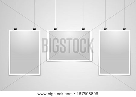 Vector posters template of a papers sheet. Posters Mock ups. Templates Posters . Blank papers in a light frames hanging with clips on a light background .