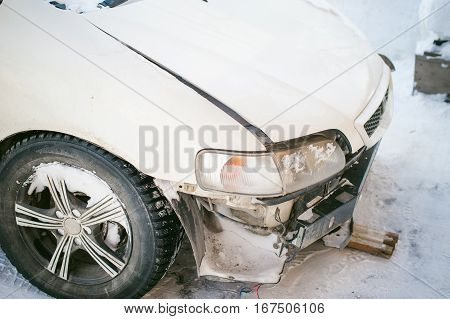 Accident Car In Snow. Twisted Metal Parts Affected By A Frontal Collision