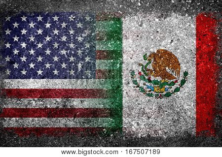Merged Flag of USA and Mexico painted on grunge concrete. Concept of Donald Trump's US immigration policy to erect concrete wall along Mexico border.