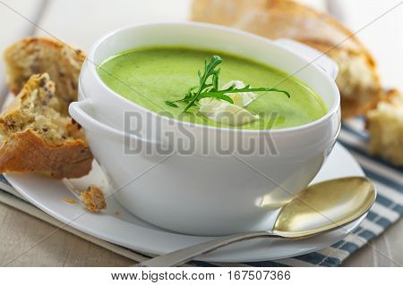 Delicious broccoli cream soup with rye bread . International cuisine meal.Close-up shot.