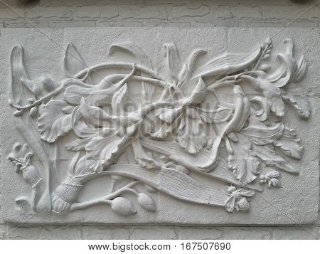 Wall bas-relief stucco in plaster depicts flowers Lily. Bangkok Thailand