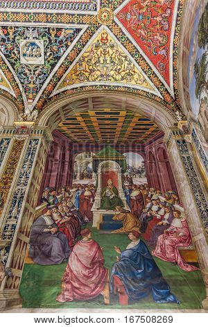 SIENA ITALY - MARCH 14 2014: Detail of fresco in The Piccolomini library inside the Siena cathedral. The library is housing precious illuminated choir books and frescoes painted by Pinturicchio.