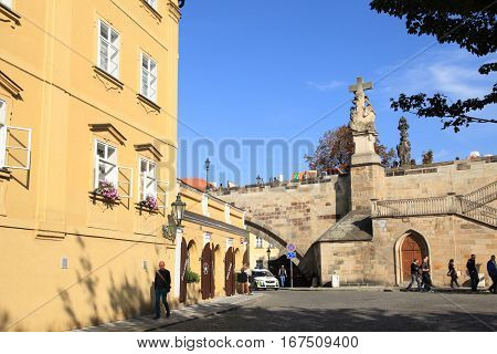 PRAGUE, CZECH REPUBLIC - OCTOBER 3, 2015: Cityview with buildings statues of Charles bridge and tourists in Mala Strana, Prague, Czech Republic.
