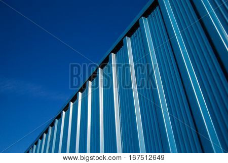 Corrugated blue steel sheet metal facade panels