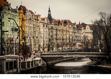 Prague, Czech Republic - 3 January 2008: View of the Vltava River with a small bridge on a cold winter afternoon