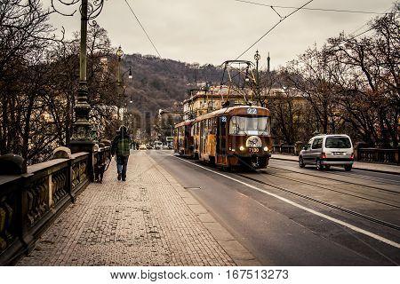 Prague, Czech Republic - 3 January 2008: A street trolley crossing a bridge over the Vltava River in central Prague