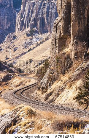 Train tracks winding through a rocky canyon