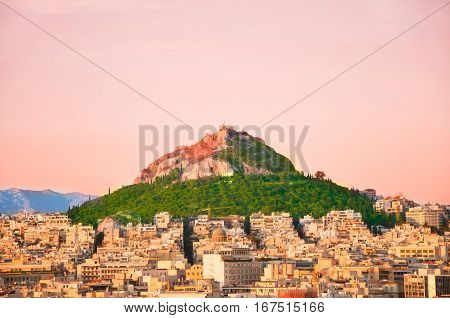 Mount Lycabettus At Sunset With Panorama Of Athens During The Evening Greece.