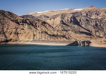Reservoir with clean drinking water surrounded by mountains