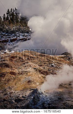 Geothermal vents with steam at Yellowstone National Park