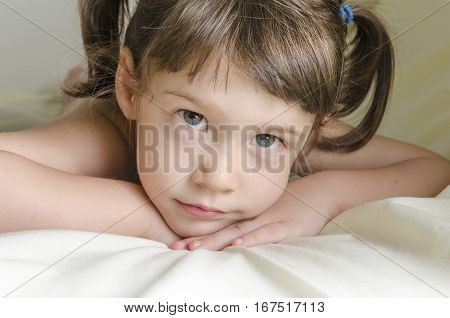 Portrait Of A Pretty Little Girl Is Daydreaming