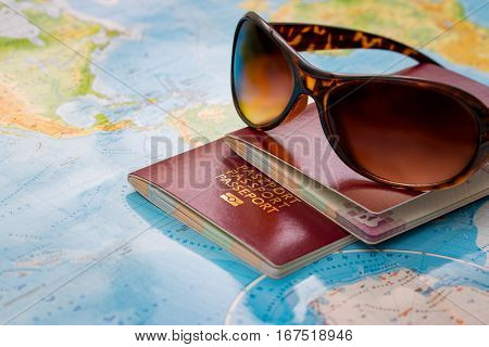 travel passport map holidays visa tourism booking sunglasses plan tourist trip world glasses summer worldmap visit concepts sanctions concept - stock image