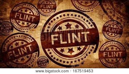 flint, vintage stamp on paper background
