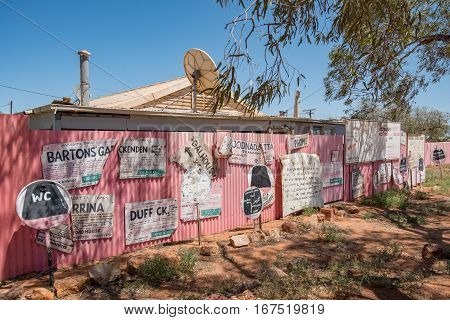 OODNADATTA AUSTRALIA - OCTOBER 24 2016: A collection of old hand painted signs at the Oodnadatta Track Outback South Australia Australia.
