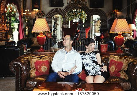 Couple Conflict Sitting On Sofa Argue Unhappy