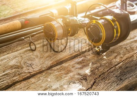 fishing rod gear background spinning wheel reel angler bait concept - stock image