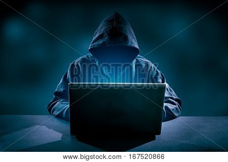 Hacker using laptop. Hacking the Internet - high resolution.