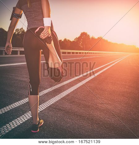 stretching run runner exercise road jogging flare sunset fitness cross sunbeam success running sportswear - stock image