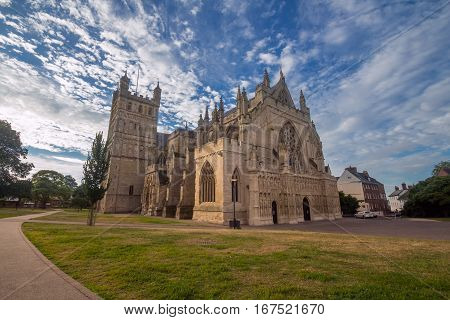Cathedral in Exeter. Early morning. Low sunlight. Blue sky with cirrus clouds. Nobody. Devon. UK