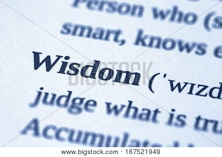 wisdom word advisability dictionary page skills studying literature wise book experience concept trust insight intelligence close up definition concept - stock image