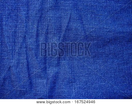 The texture is denim blue with pleats