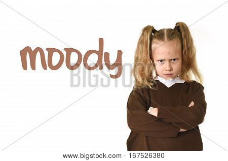 English language learning vocabulary school card with word moody and sweet young schoolgirl with blond hair and folded arms angry and upset frustrated and unhappy face expression
