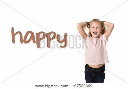 English language learning vocabulary school card of young beautiful happy female child gesturing excited and smiling cheerful rising arms isolated on white background in school girl success
