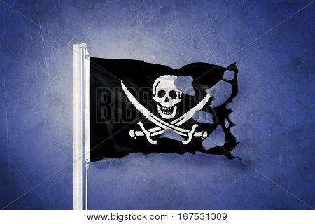 Torn Jolly Roger Pirate flag blowing in the wind.