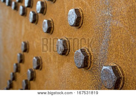 Rusty bridge components are captured is a textured abstract.